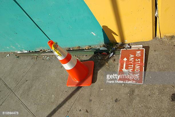 High angle view of traffic cone and warning sign on street