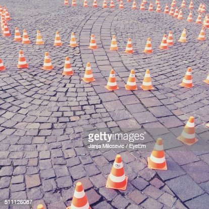 High angle view of traffic cones on cobbled street
