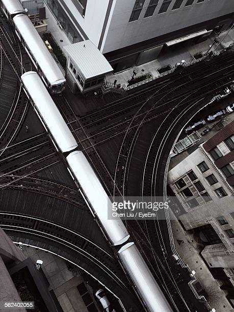 High Angle View Of Trains Along Cropped Built Structures