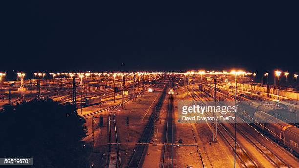 High Angle View Of Trains On Illuminated Tracks Against Clear Sky At Night