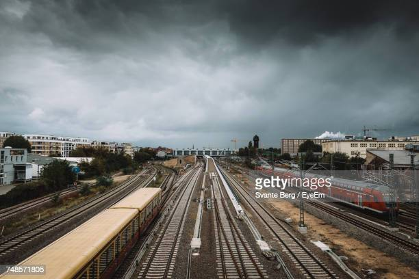 High Angle View Of Trains On Railroad Tracks Against Cloudy Sky