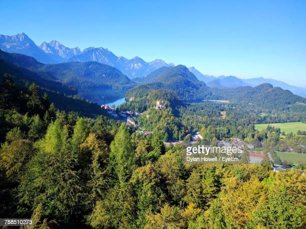 High Angle View Of Trees And Mountains Against Clear Blue Sky
