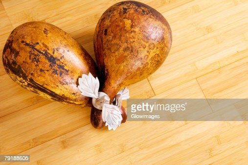 High angle view of two dried gourds on a wooden floor : Foto de stock