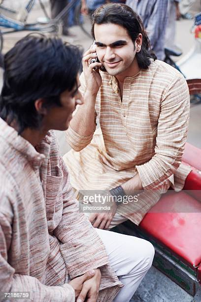 High angle view of two young men sitting in a rickshaw