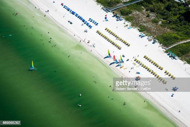 High Angle View Of Umbrellas At Beach On Sunny Day