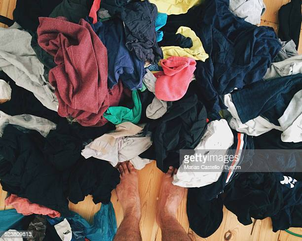 High Angle View Of Unwashed Clothes On Floor