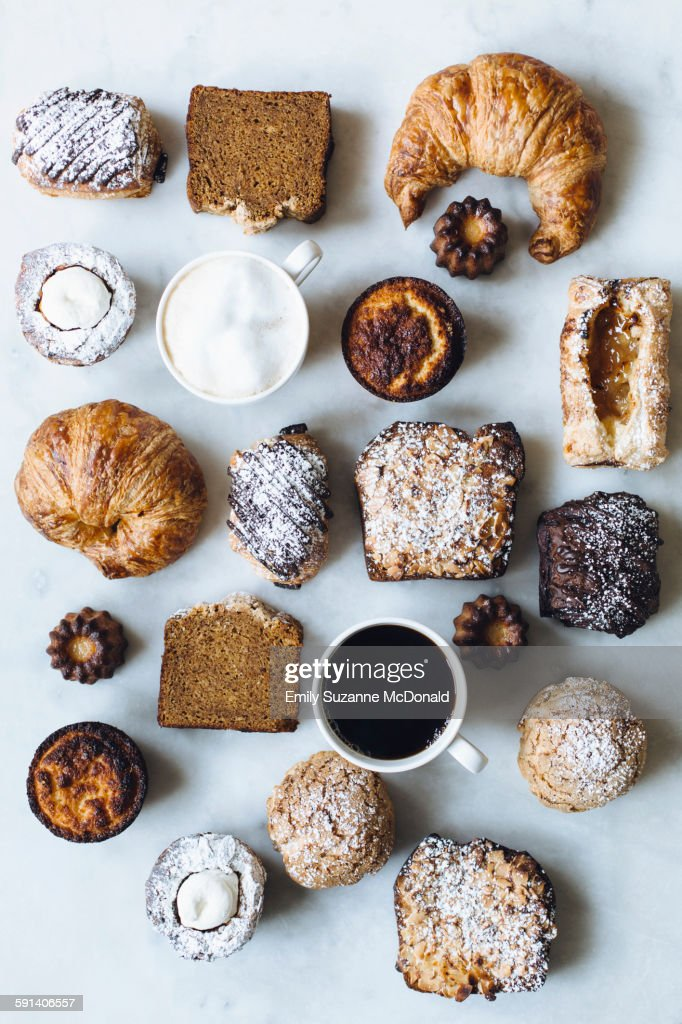 High angle view of variety of pastries and coffee