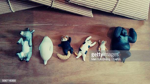 High Angle View Of Various Animal Toys On Hardwood Floor