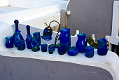 High Angle View Of Various Blue Glass Equipment On Wall