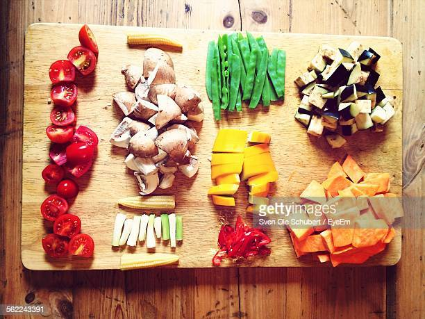 High Angle View Of Various Chopped Vegetable On Cutting Board