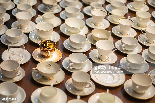 High Angle View Of Various Coffee Cups Arranged On Table