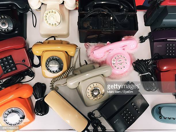 High Angle View Of Various Landline Phones On Table
