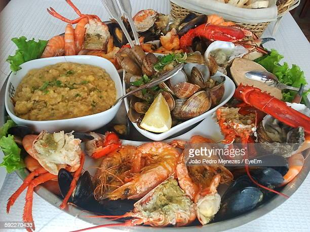 High Angle View Of Various Seafood Served In Plate On Table
