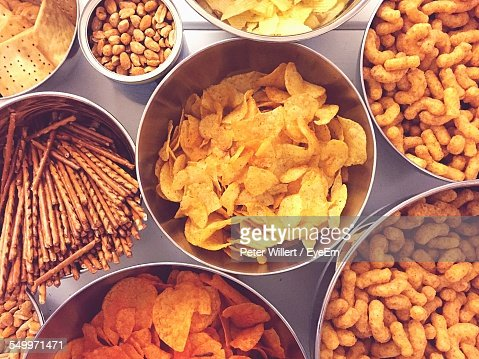 High Angle View Of Various Snacks In Bowls