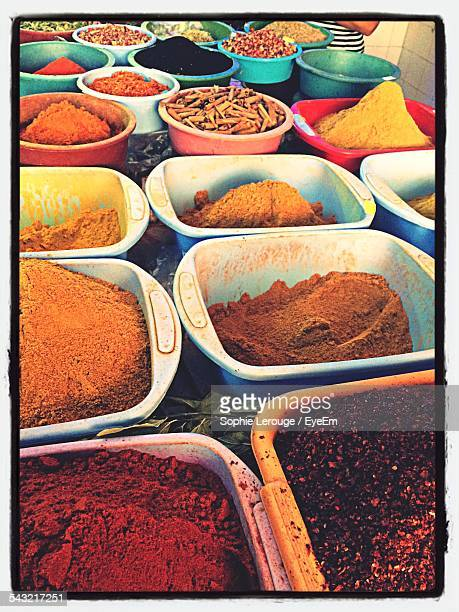 High Angle View Of Various Spices In Bowls At Market Stall For Sale