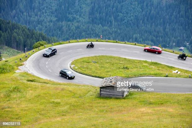 High Angle View Of Vehicles On Winding Road At Mountain