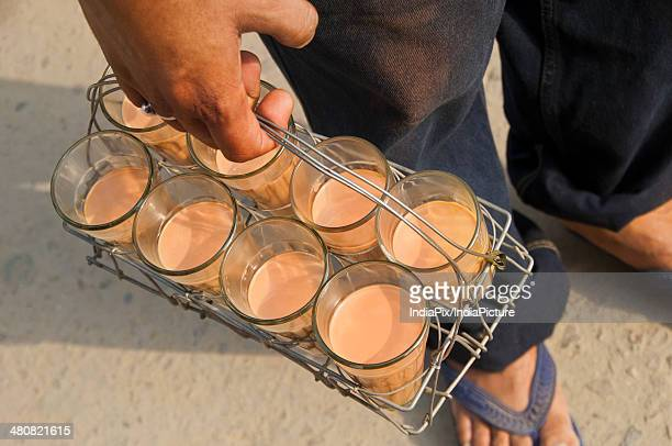 High angle view of vendor carrying tea glasses on street