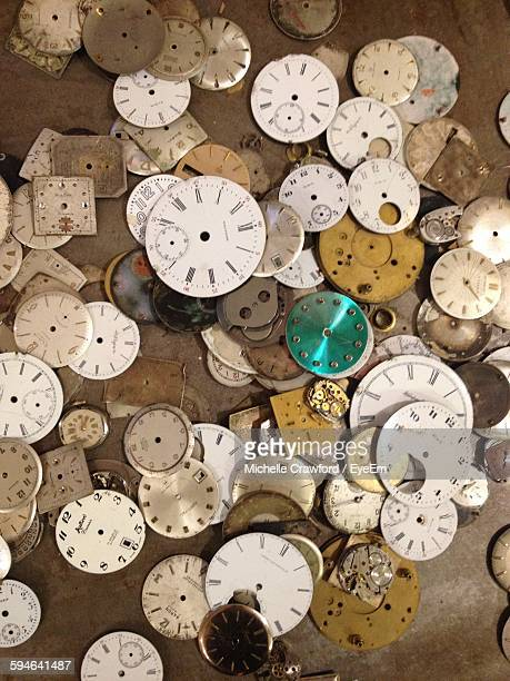 High Angle View Of Vintage Clock Parts On Table