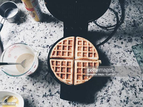 High Angle View Of Waffles On Iron