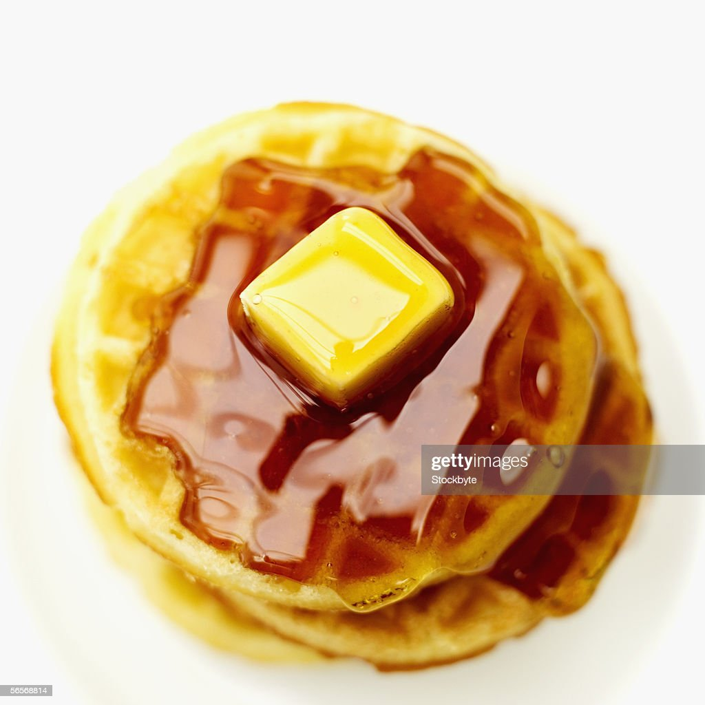 high angle view of waffles served with syrup and butter