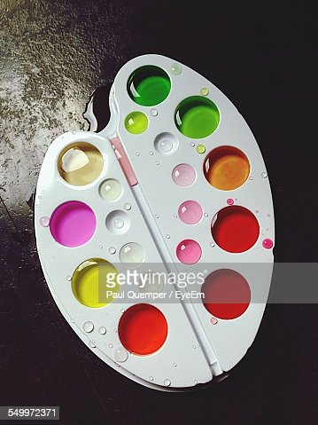 High Angle View Of Watercolor Paint Palette On Table