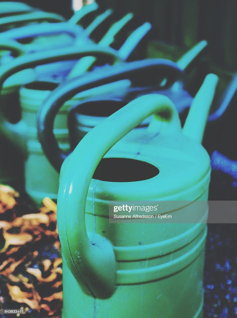 High Angle View Of Watering Cans