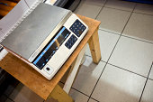 High angle view of weighing machine on stool in supermarket