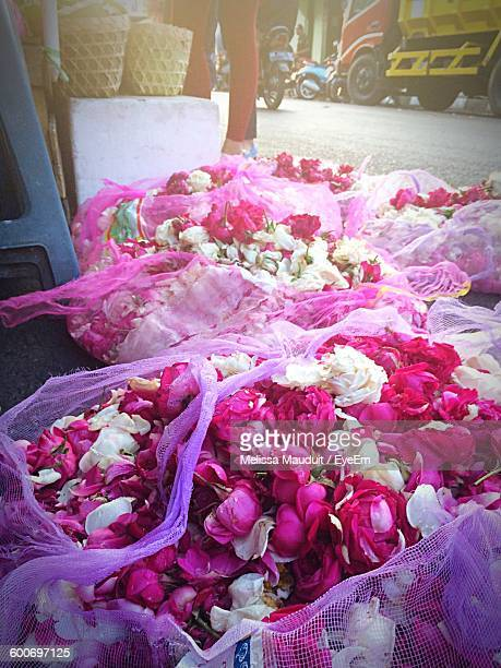 High Angle View Of White And Pink Roses On Street