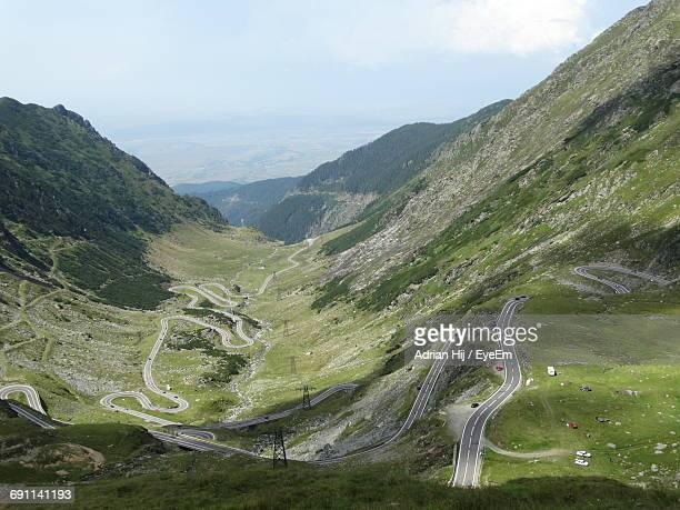 High Angle View Of Winding Roads On Mountain Against Sky