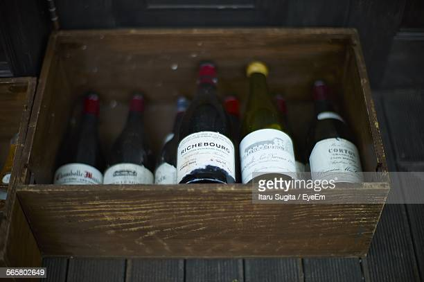 High Angle View Of Wine Bottles In Wooden Box