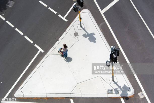 High Angle View Of Woman At Intersection