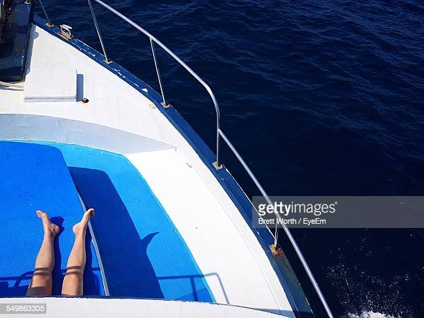 High Angle View Of Woman Lying On Boat Deck