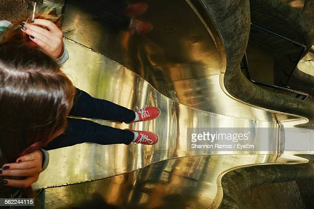 High Angle View Of Woman Standing In Slide