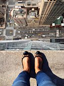 High Angle View Of Woman Standing On Rooftop