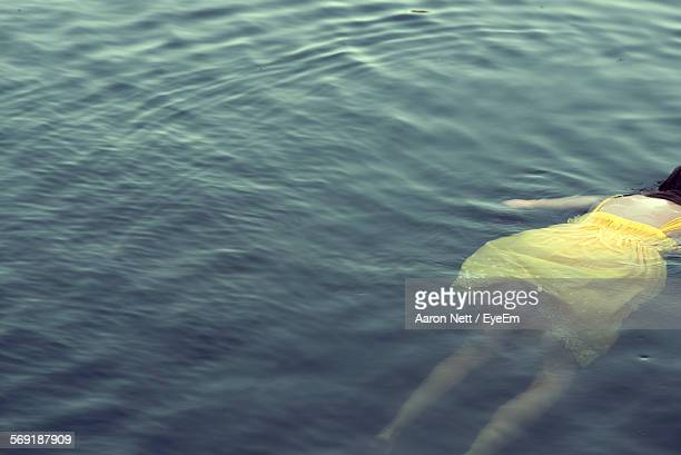 High angle view of woman swimming in river