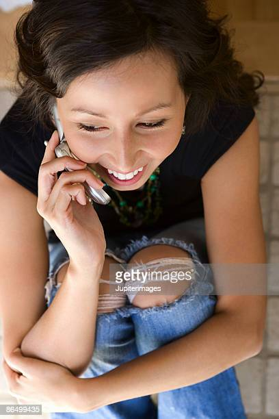 High angle view of woman using cell phone