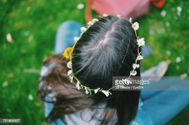 High Angle View Of Woman Wearing Tiara While Sitting On Grass
