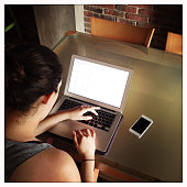 High Angle View Of Woman Working On Laptop At Home