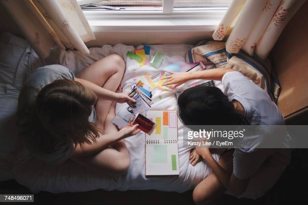 High Angle View Of Women Doing Art And Craft