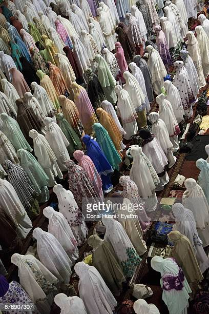 High Angle View Of Women In Tradition Clothing Praying During Ramadan
