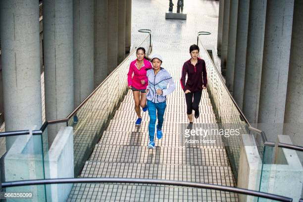 High angle view of women running on staircase