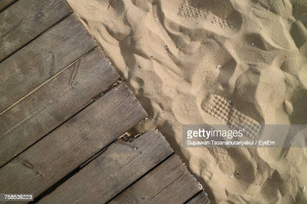 High Angle View Of Wood On Sand