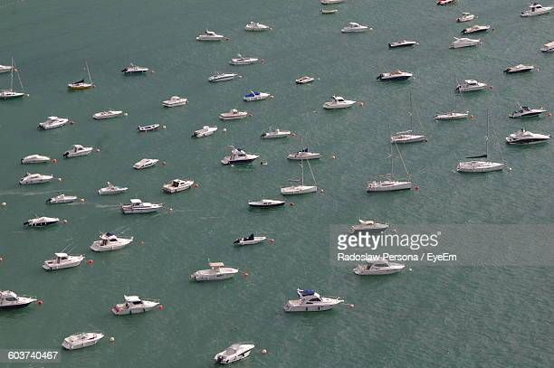 High Angle View Of Yachts Anchored In Sea