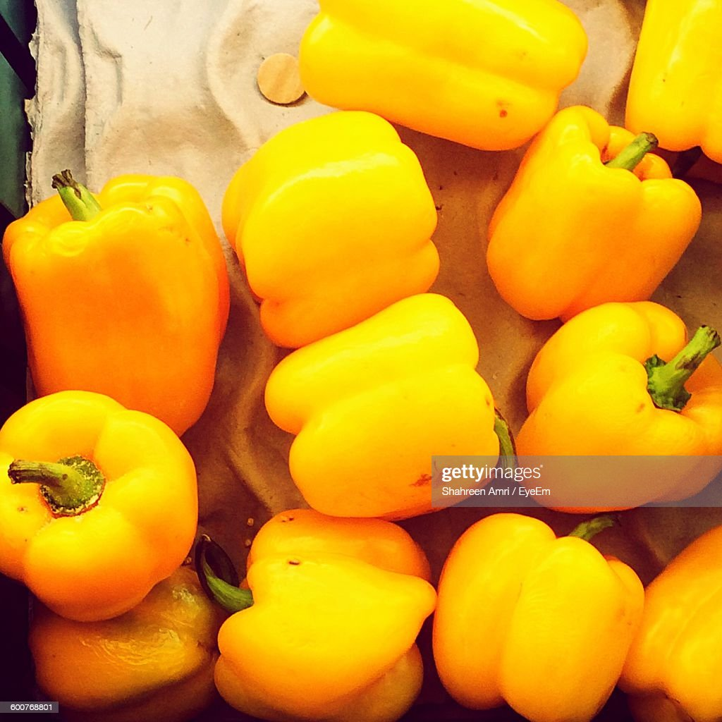 High Angle View Of Yellow Bell Peppers At Market Stall