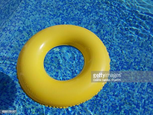 High Angle View Of Yellow Inflatable Ring In Swimming Pool
