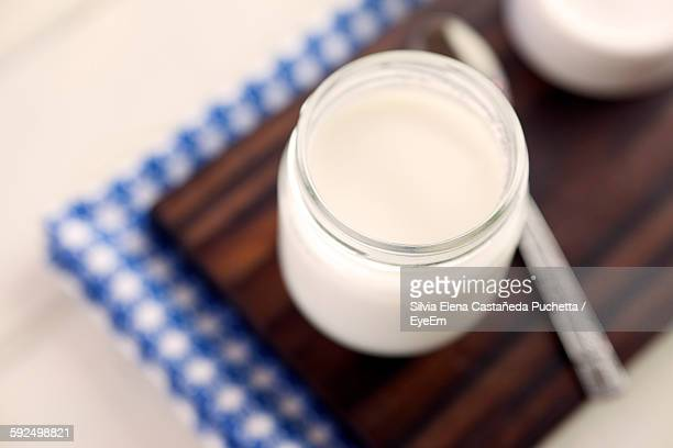 High Angle View Of Yogurt In Jar On Table