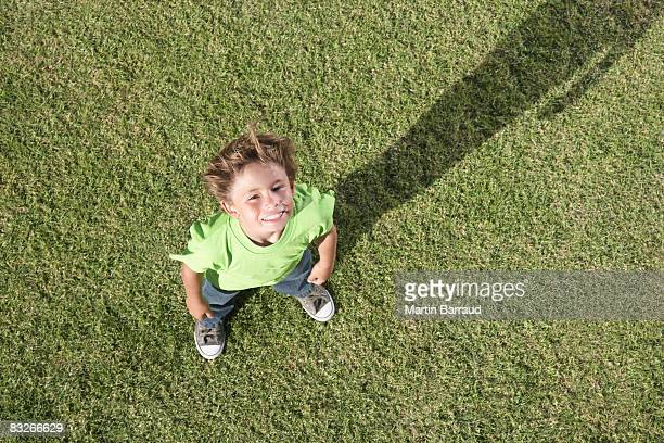 High angle view of young boy looking at camera