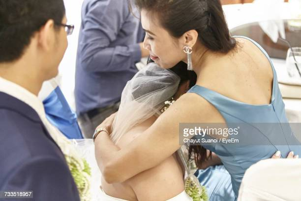 High Angle View Of Young Woman Embracing Bride
