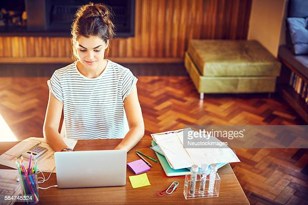 High angle view of young woman working at table