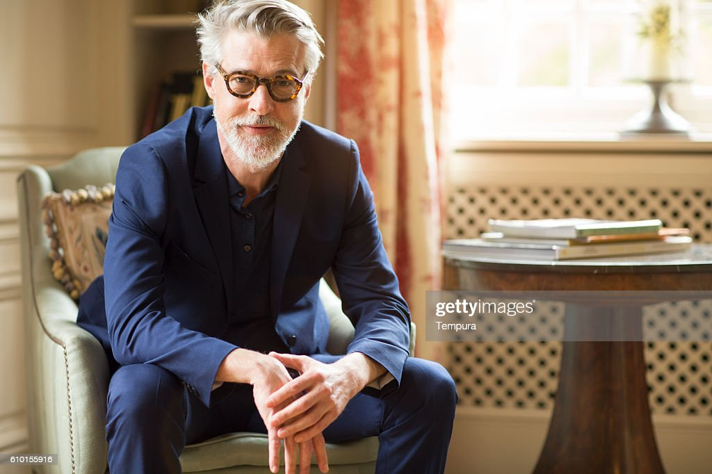 High class mature man portrait at home. : Stock Photo